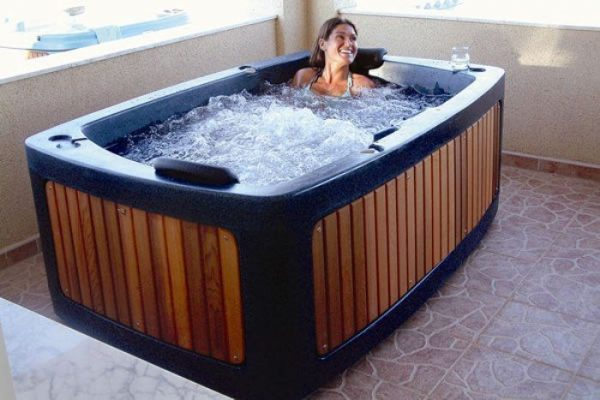 woman in hot tub blue Eazy Direct roto spa lazy spa hot tub 0% finance waterfall lights RotoSpa Orbis grey eazy hire easy direct payl8r pay monthly pay weekly hot tub low credit bnm wayfair the range cheap hot tub buy now pay later lay z spa hot tub financing Eazy hot tubs
