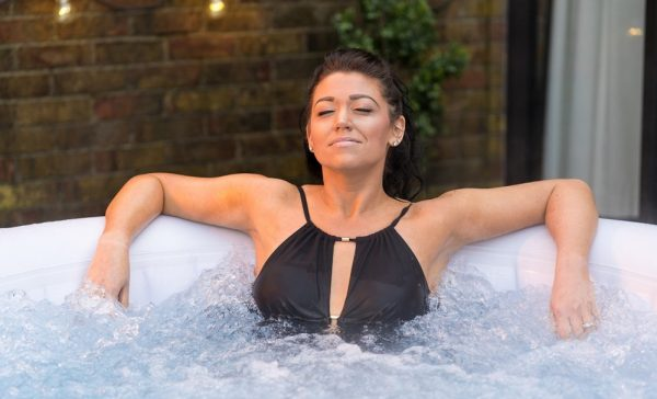 woman in Miami hot tub lay-z spa miami hot tub, lazy spa Miami hot tub Eazy Direct payl8r hot tub 0% finance payl8r pay monthly pay weekly hot tub low credit bnm wayfair the range cheap hot tub buy now pay later lay z spa layzspa hot tub vegas from above inflatable financing low credit bad credit